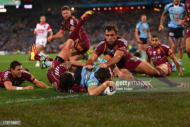 James McManus of the Blues scores a try during game three of the ARL State of Origin series between the New South Wales Blues and the Queensland...