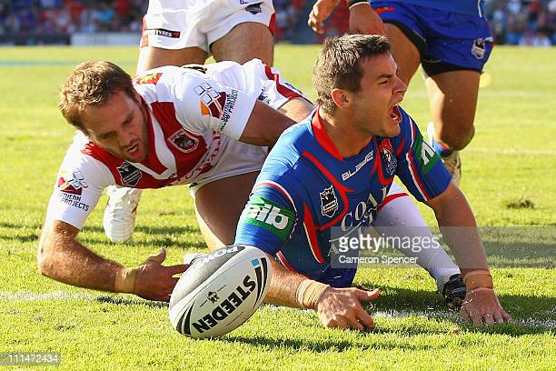 James McManus of the Knights celebrates scoring a try during the round four NRL match between the Newcastle Knights and the St George Illawarra...