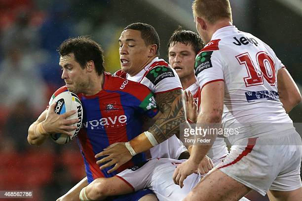 James McManus of the Knights is tackled by Tyson Frizell of the Dragons during the round five NRL match between the Newcastle Knights and the St...