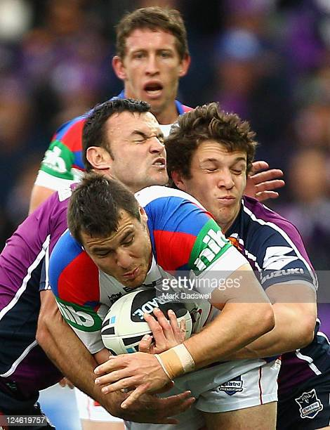 James McManus of the Knights is tackled during the NRL 4th Qualifying Final match between the Melbourne Storm and the Newcastle Knights at AAMI Park...