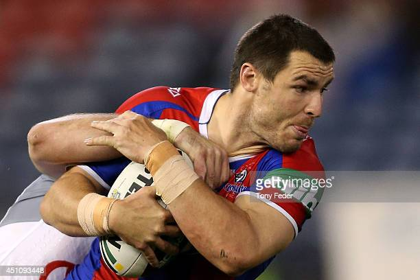James McManus of the Knights is tackled during the round 15 NRL match between the Newcastle Knights and the North Queensland Cowboys at Hunter...