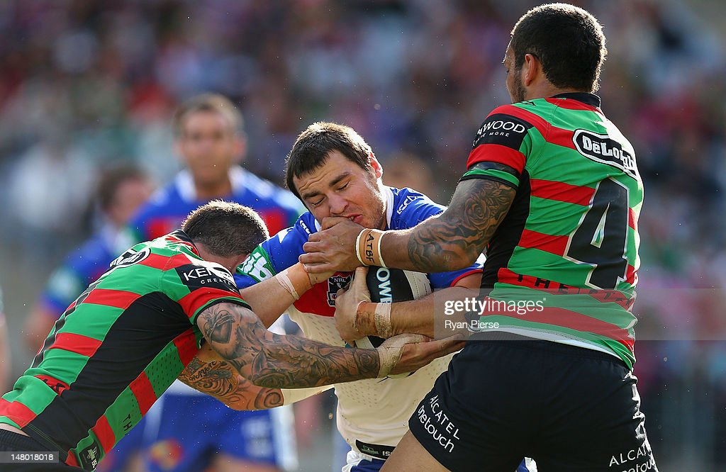 James McManus of the Knights is tackled during the round 18 NRL match between the South Sydney Rabbitohs and the Newcastle Knights at ANZ Stadium on July 8, 2012 in Sydney, Australia.