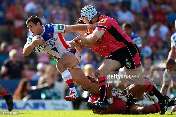 James McManus of the Knights is tackled during the round one NRL match between the Penrith Panthers and the Newcastle Knights at Sportingbet Stadium...