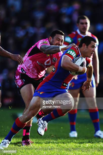 James McManus of the Knights makes a break during the round 11 NRL match between the New Zealand Warriors and the Newcastle Knights at Mt Smart...