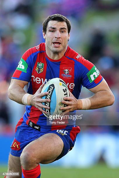 James McManus of the Knights runs the ball during the round 13 NRL match between the Newcastle Knights and Canberra Raiders at Hunter Stadium on June...