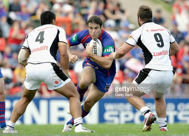 James McManus of the Knights runs the ball during the round five NRL match between the Newcastle Knights and the New Zealand Warriors at...