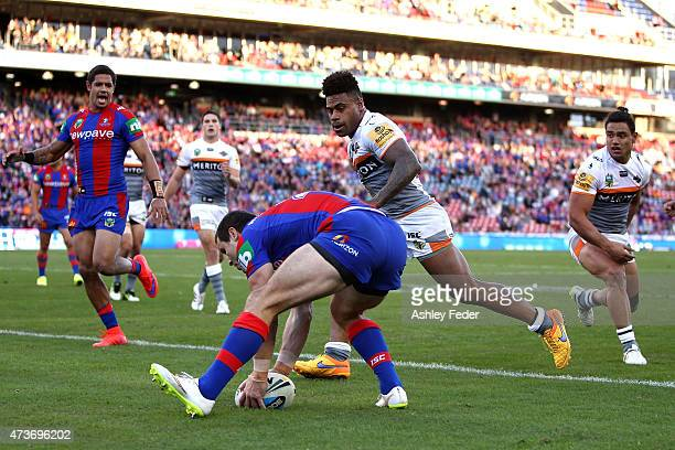 James McManus of the Knights scores a try during the round 10 NRL match between the Newcastle Knights and the Wests Tigers at Hunter Stadium on May...