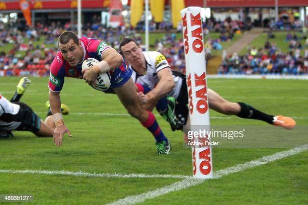 James McManus of the Knights scores a try during the round 9 NRL match between the Newcastle Knights and the Penrith Panthers at Hunter Stadium on...