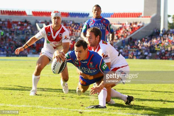 James McManus of the Knights scores a try during the round four NRL match between the Newcastle Knights and the St George Illawarra Dragons at...