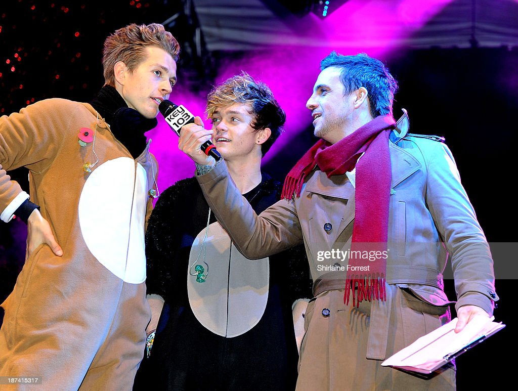 James McVey and Connor Ball of The Vamps with Mike Toolan onstage at the switch on of the Manchester Christmas lights at Albert Square on November 8, 2013 in Manchester, England.