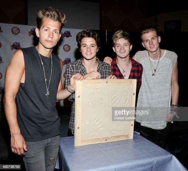 R James McVey Brad Simpson Connor Ball and Tristan Evans of The Vamps visit at Planet Hollywood Times Square on June 16 2014 in New York City