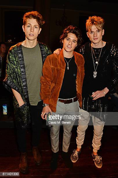 James McVey Bradley Simpson and Tristan Evans of The Vamps attend the Julien Macdonald show during London Fashion Week Autumn/Winter 2016/17 at One...