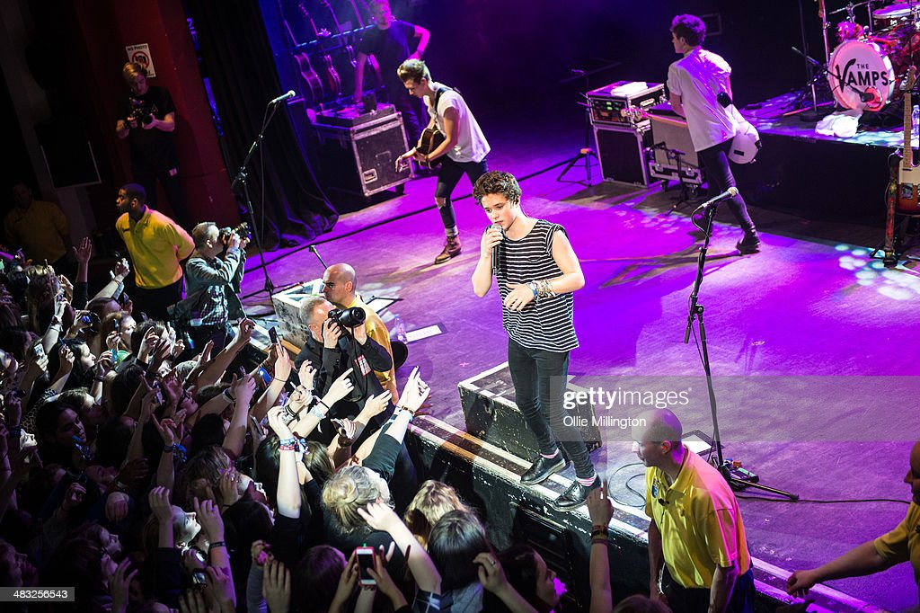 James McVey, Bradley Will 'Brad' Simpson, Tristan Evans and Connor Ball of The Vamps performs on stage during the 'The Last Night' single launch party, the band's first UK headline show, at at Shepherds Bush Empire on April 7, 2014 in London, United Kingdom.