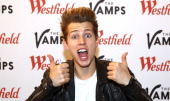 james McVey of The Vamps poses for a photo before a signing for fans at Westfield Stratford City on April 14 2014 in London England