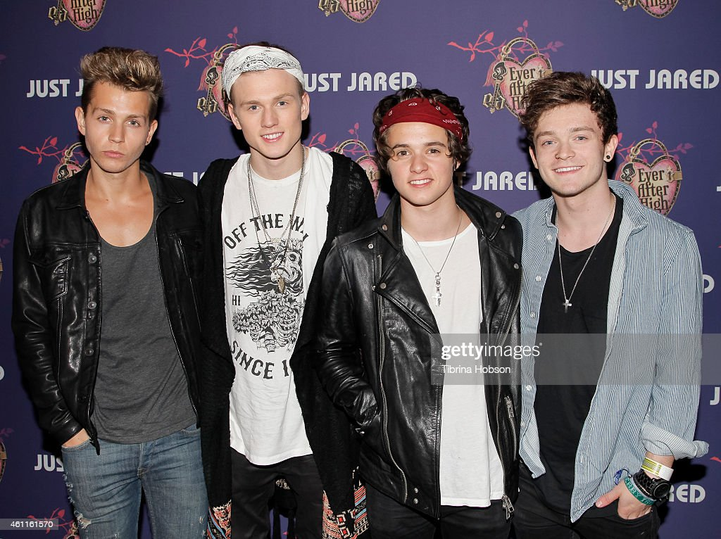 James McVey, Tristan Evans, Brad Simpson and Connor Ball of The Vamps attend Just Jared's homecoming dance at El Rey Theatre on November 20, 2014 in Los Angeles, California.