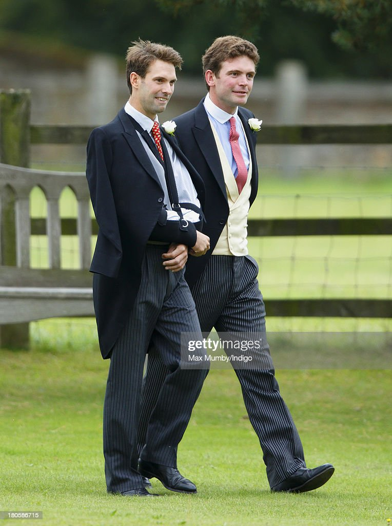 James Meade accompanied by his brother Harry Meade arrives for his wedding to Lady Laura Marsham at the Parish Church of St Nicholas in Gayton on...
