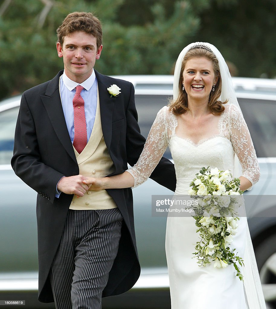 James Meade and Lady Laura Marsham leave the Parish Church of St. Nicholas in Gayton after their wedding on September 14, 2013 near King's Lynn, England.