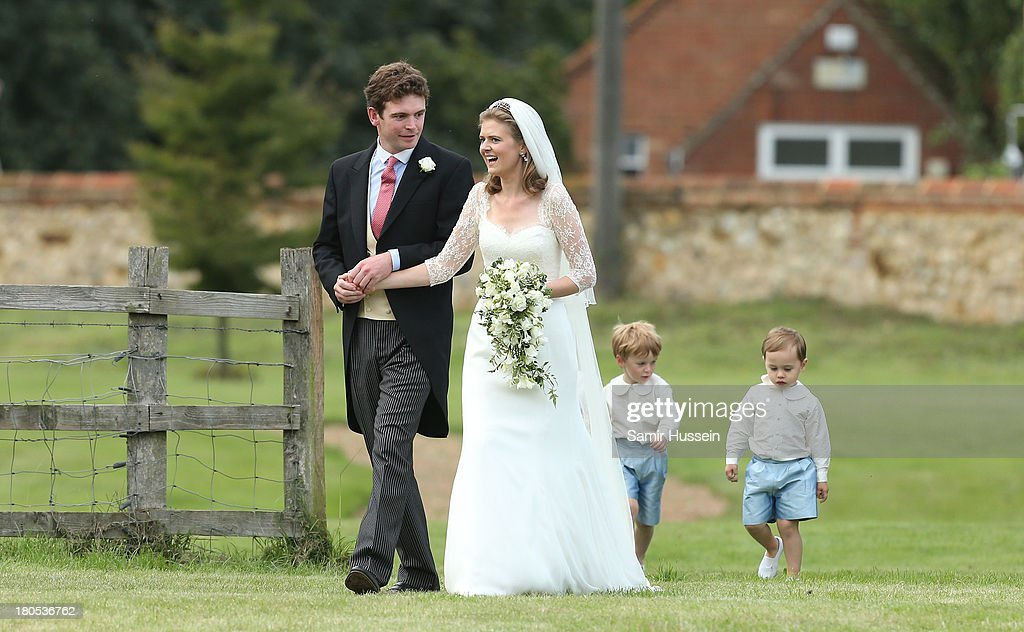 James Meade and Lady Laura Marsham leave their wedding at the parish church of St Nicholas in Gayton on September 14, 2013 in King's Lynn, England.