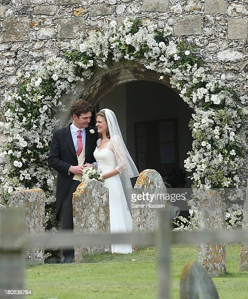 James Meade and Lady Laura Marsham leave their wedding at the parish church of St Nicholas in Gayton on September 14 2013 in King's Lynn England