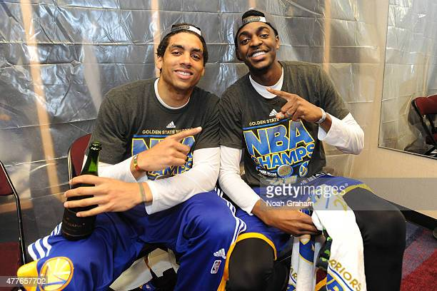 James Micahael McAdoo and Justin Holiday of the Golden State Warriors celebrates winning the Larry O'Brein Trophy after Game Six of the 2015 NBA...