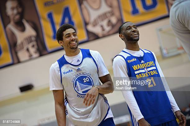 James Michael McAdoo and Ian Clark of the Golden State Warriors smile and look on during an AllAccess practice on March 26 2016 at Oakland Convention...