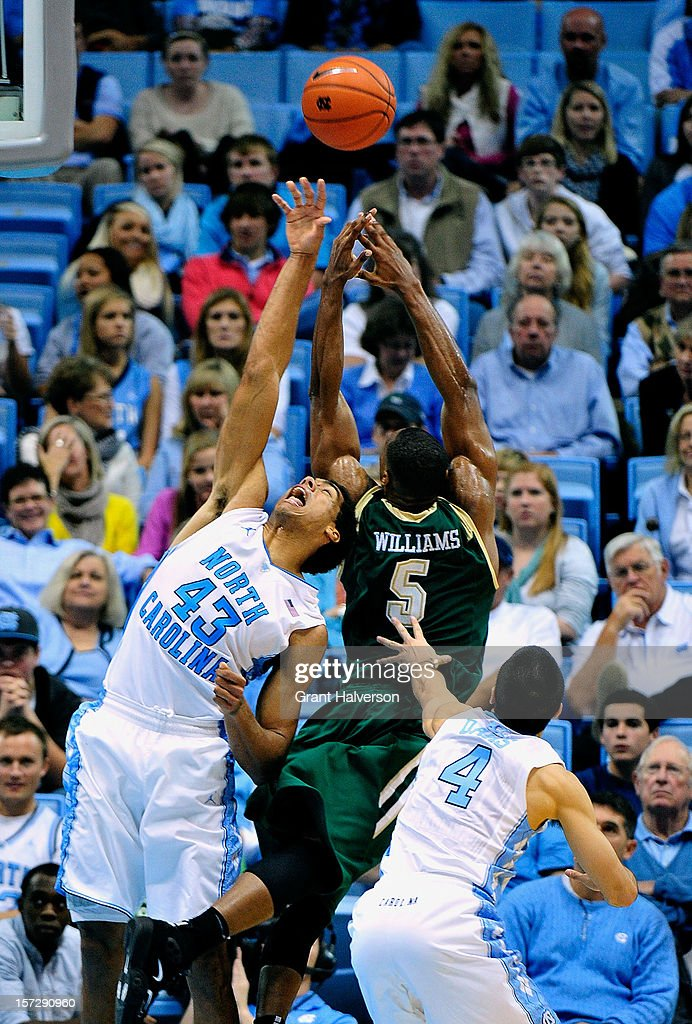 James Michael McAdoo #43 and Luke Davis #4 of the North Carolina Tar Heels battle for a rebound with Robert Williams #5 of the UAB Blazers during play at the Dean Smith Center on December 1, 2012 in Chapel Hill, North Carolina. North Carolina won 102-84.