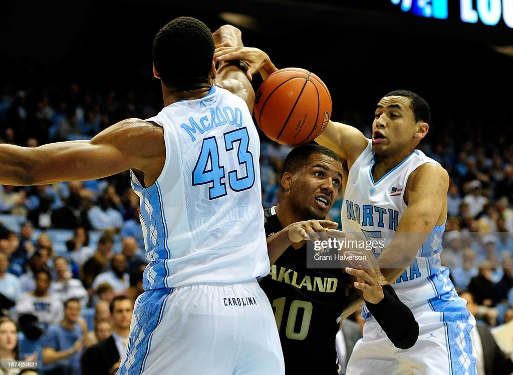 James Michael McAdoo #43 and Marcus Paige #5 of the North Carolina Tar Heels force a turnover by Duke Mondy #10 of the Oakland Golden Grizzlies during play at the Dean Smith Center on November 8, 2013 in Chapel Hill, North Carolina.