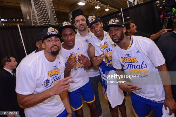 James Michael McAdoo Damian Jones Zaza Pachulia Patrick McCaw and Ian Clark of the Golden State Warriors pose for a photo after winning Game Four of...