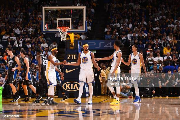 James Michael McAdoo Ian Clark Patrick McCaw and Shaun Livingston of the Golden State Warriors celebrate during a game against the Orlando Magic on...