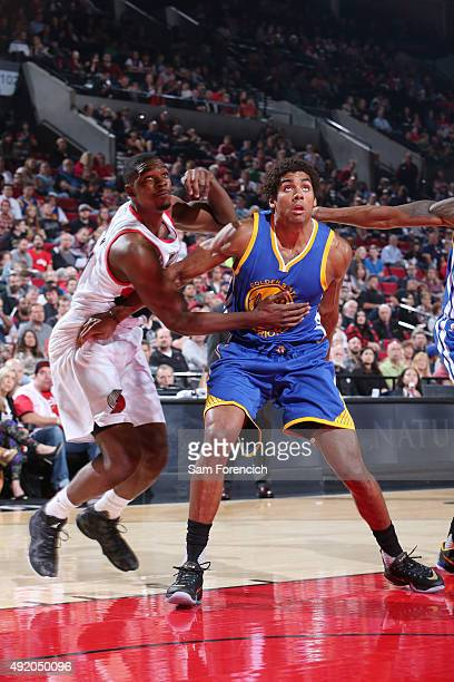 James Michael McAdoo of the Golden State Warriors boxes out against Noah Vonleh of the Portland Trail Blazers during a preseason game on October 8...