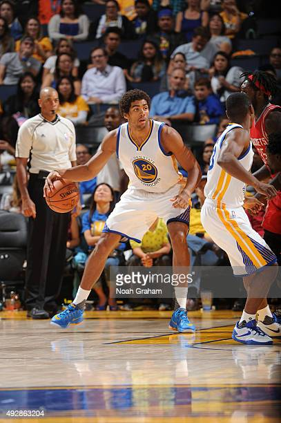 James Michael McAdoo of the Golden State Warriors dribbles the ball against the Houston Rockets on October 15 2015 at Oracle Arena in Oakland...