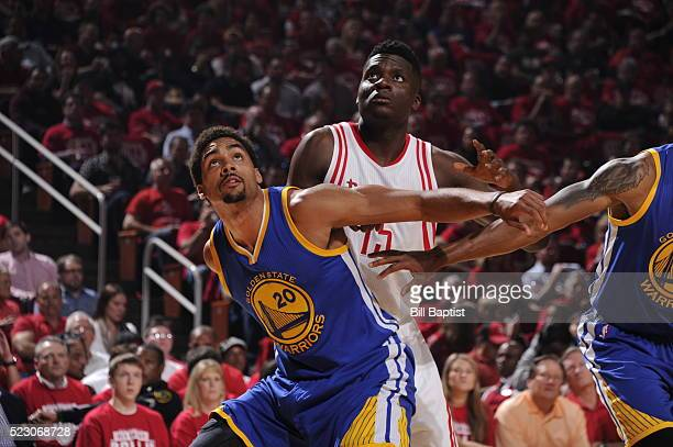 James Michael McAdoo of the Golden State Warriors fights for position against Clint Capela of the Houston Rockets in Game Three of the Western...