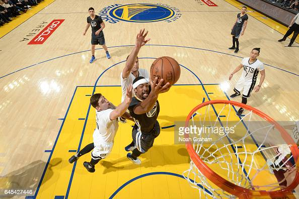 James Michael McAdoo of the Golden State Warriors goes to the basket against the Brooklyn Nets on February 25 2017 at ORACLE Arena in Oakland...