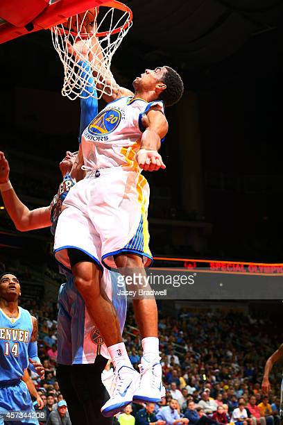 James Michael McAdoo of the Golden State Warriors goes up for a dunk against the Denver Nuggets in an NBA PreSeason game on October 16 2014 at the...