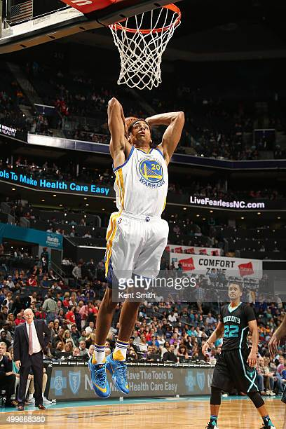 James Michael McAdoo of the Golden State Warriors goes up for a dunk against the Charlotte Hornets on December 2 2015 at Time Warner Cable Arena in...