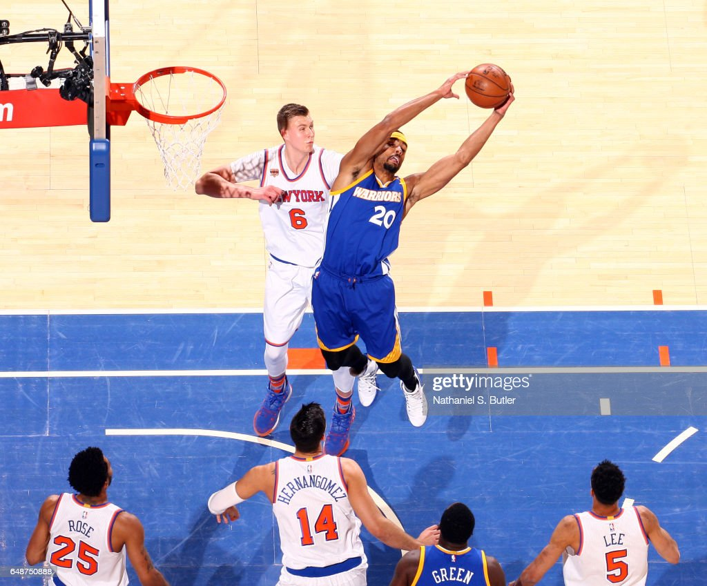 James Michael McAdoo #20 of the Golden State Warriors grabs the rebound against the New York Knicks #27 on March 5, 2017 at Madison Square Garden in New York City, New York.