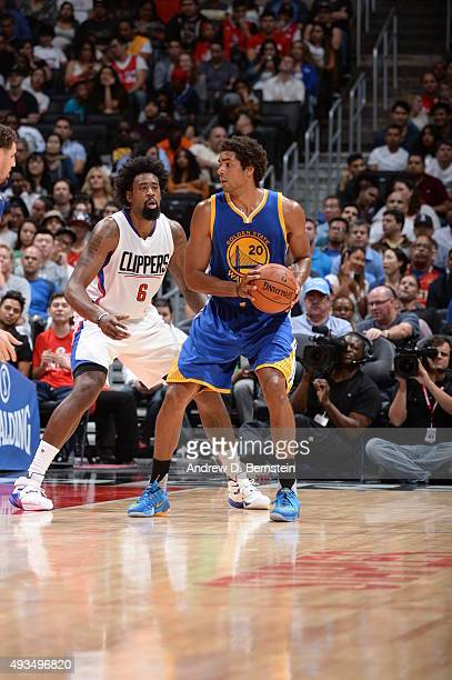 James Michael McAdoo of the Golden State Warriors handles the ball against DeAndre Jordan of the Los Angeles Clippers on October 20 2015 at STAPLES...