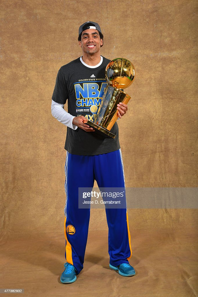 <a gi-track='captionPersonalityLinkClicked' href=/galleries/search?phrase=James+Michael+McAdoo&family=editorial&specificpeople=7908952 ng-click='$event.stopPropagation()'>James Michael McAdoo</a> of the Golden State Warriors poses for a portrait with the Larry O'Brien trophy after defeating the Cleveland Cavaliers in Game Six of the 2015 NBA Finals on June 16, 2015 at Quicken Loans Arena in Cleveland, Ohio.