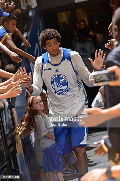James Michael McAdoo of the Golden State Warriors runs out and shakes hands before an open practice on October 14 2015 at Oracle Arena in Oakland...