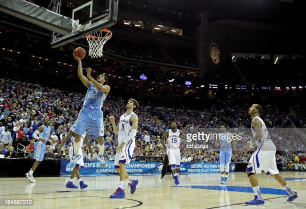 James Michael McAdoo of the North Carolina Tar Heels attempts a shot against Jeff Withey of the Kansas Jayhawks during the third round of the 2013...