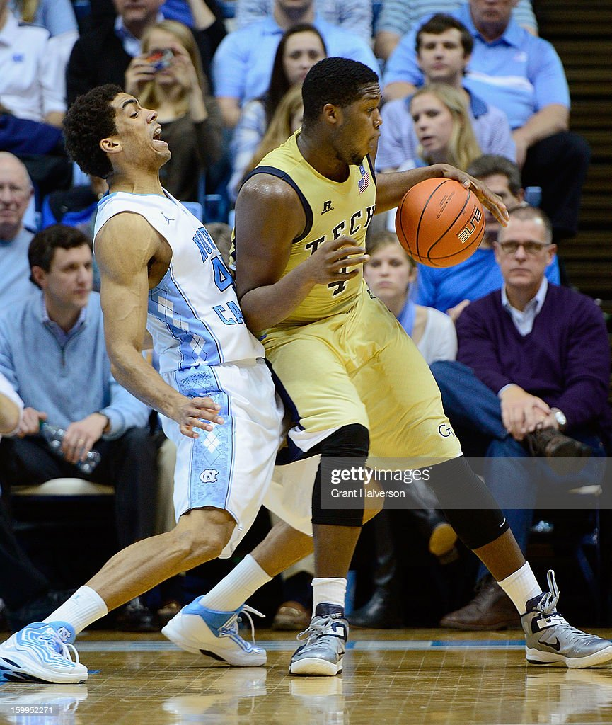 James Michael McAdoo #43 of the North Carolina Tar Heels attempts to draw a charging foul on Robert Carter Jr. #4 of the Georgia Tech Yellow Jackets during play at the Dean Smith Center on January 23, 2013 in Chapel Hill, North Carolina. North Carolina won 79-63.