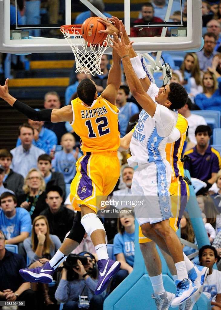 James Michael McAdoo #43 of the North Carolina Tar Heels battles for a rebound with Robert Sampson #12 of the East Carolina Pirates during play at the Dean Smith Center on December 15, 2012 in Chapel Hill, North Carolina.
