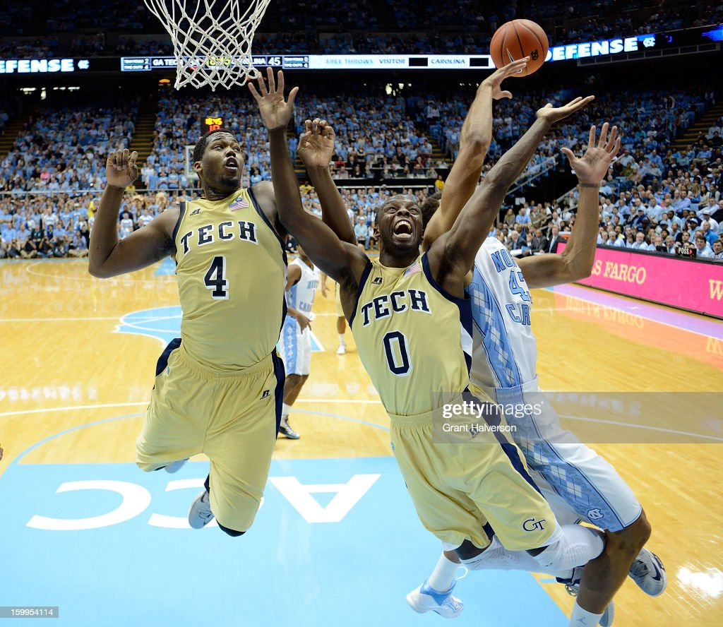 James Michael McAdoo #43 of the North Carolina Tar Heels battles for a rebound with Marcus Georges-Hunt #4 and Mfon Udofia #0 of the Georgia Tech Yellow Jackets during play at the Dean Smith Center on January 23, 2013 in Chapel Hill, North Carolina. North Carolina won 79-63.