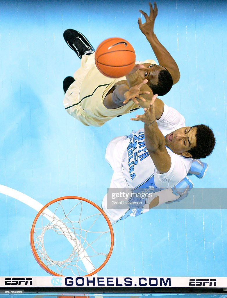 James Michael McAdoo #43 of the North Carolina Tar Heels battles for a rebound against Travis McKie #30 of the Wake Forest Demon Deacons during play at the Dean Smith Center on February 5, 2013 in Chapel Hill, North Carolina. North Carolina won 87-62.