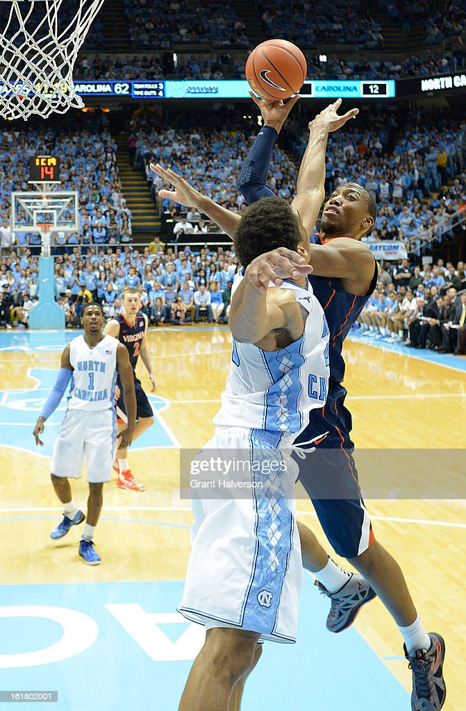 James Michael McAdoo #43 of the North Carolina Tar Heels defends a shot by Akil Mitchell #25 of the Virginia Cavaliers during play at the Dean Smith Center on February 16, 2013 in Chapel Hill, North Carolina. North Carolina won 93-81.