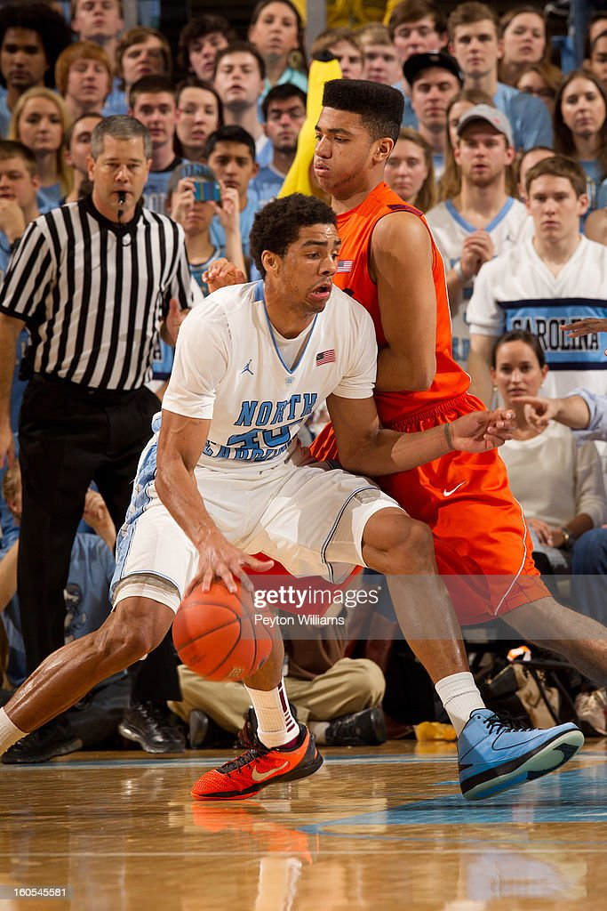 James Michael McAdoo #43 of the North Carolina Tar Heels dribbles around forward Marshall Wood #33 of the Virginia Tech Hokies on February 02, 2013 at the Dean E. Smith Center in Chapel Hill, North Carolina. North Carolina won 60-72 in overtime.