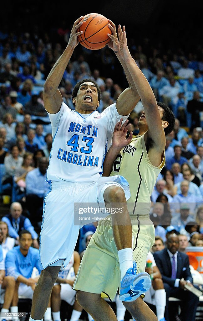 James Michael McAdoo #43 of the North Carolina Tar Heels drives against Devin Thomas #2 of the Wake Forest Demon Deacons during play at the Dean Smith Center on February 5, 2013 in Chapel Hill, North Carolina. North Carolina won 87-62.