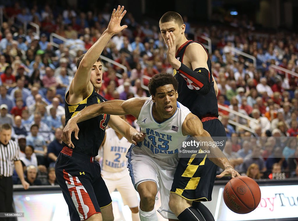 James Michael McAdoo #43 of the North Carolina Tar Heels drives between Logan Aronhalt #2 and Alex Len #25 of the Maryland Terrapins in the second half during the men's ACC Tournament semifinals at Greensboro Coliseum on March 16, 2013 in Greensboro, North Carolina.