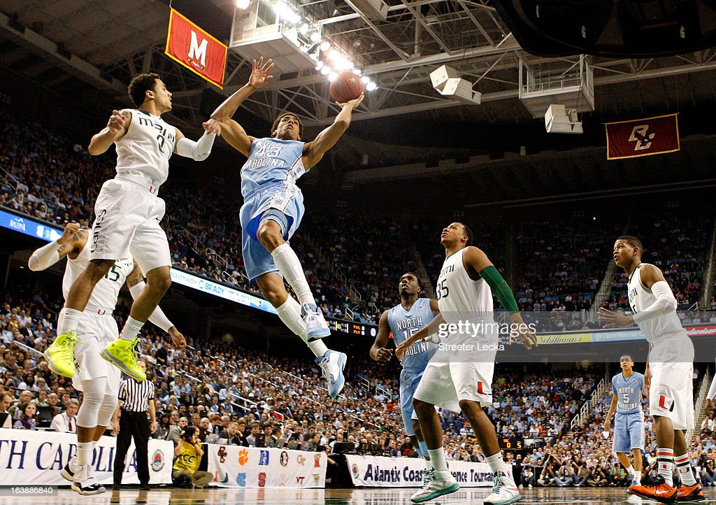 James Michael McAdoo #43 of the North Carolina Tar Heels drives for a shot attempt in the first half against Shane Larkin #0 and Kenny Kadji (C) #35 of the Miami (Fl) Hurricanes during the final of the Men's ACC Basketball Tournament at Greensboro Coliseum on March 17, 2013 in Greensboro, North Carolina.