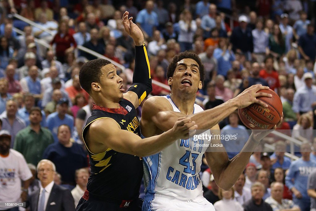 James Michael McAdoo #43 of the North Carolina Tar Heels drives on Seth Allen #4 of the Maryland Terrapins in the second half during the men's ACC Tournament semifinals at Greensboro Coliseum on March 16, 2013 in Greensboro, North Carolina.